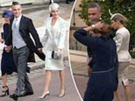 Eugenie royal wedding: Robbie Williams' mother-in-law's hat flies off