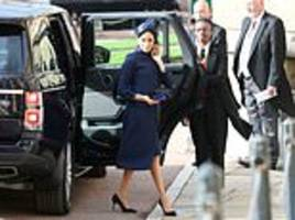 meghan dons dress by favourite givenchy for eugenie royal wedding