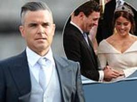 Robbie Williams chews GUM at Princess Eugenie's royal wedding