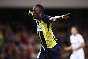 Usain Bolt just scored twice on his first professional football start - with a little help from a former Cardiff City and Aston Villa star