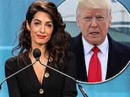 Amal Clooney skips royal wedding to take a hit at President Trump for mocking Christine Ford