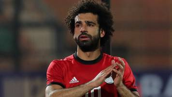Salah returns to Liverpool after limping out of Egypt game
