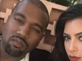 kanye west & kim kardashian arrive in africa for weeklong stay, big sean staying at same 5-star hotel