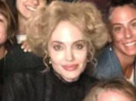 angelina jolie dons a blonde bouffant for her latest flick and looks totally unrecognizable