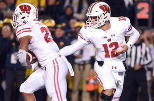 badgers slip to no. 23 after second loss