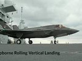 british pilot makes history with 'rolling landing' on aircraft carrier