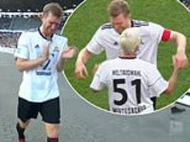emotional per mertesacker retires in tears as he is replaced by his father during his testimonial