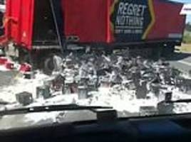 truck driver is left with a hangover after beer crates  fall off lorry in south africa