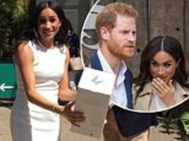 Duchess of Sussex Meghan Markle smiles as she receives another very Australian gift from Taronga Zoo