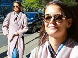 katie holmes looks happy as she models pink coat after busy philipps said she was 'hard to connect'