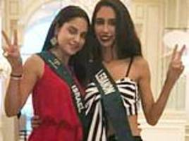 miss earth lebanon is stripped of her title after posing for a photo with miss earth israel