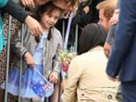 Prince Harry calls his wife Meghan over to meet a five-year-old girl