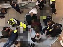 westfield shopping centre: horror as man falls from top floor