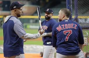cora guides red sox, inspires team back home in puerto rico