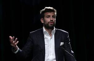 gerard pique juggles business with soccer at barcelona