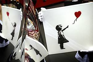 banksy posts video suggesting auctioned painting should have shredded all the way (video)