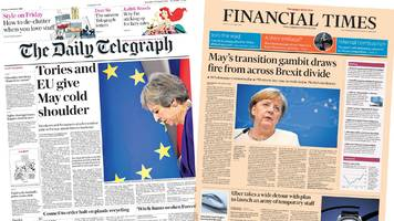 newspaper headlines: 'may's transition gambit draws fire'