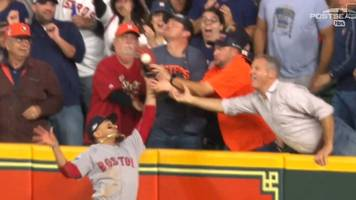 watch: fan costs houston astros by blocking 'amazing leap' from red sox player