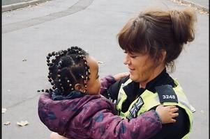 young birmingham girl's heart-warming words as she embraces ladywood police officer