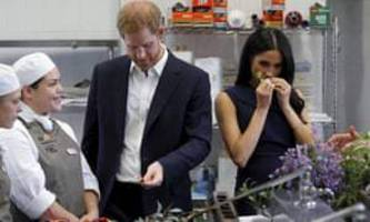 prince harry and meghan in melbourne: bush tucker, the beach and a bit of footy