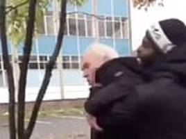 Horrifying moment a thug grabs a terrified pensioner and hurls him to the ground