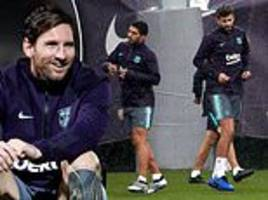 lionel messi and his barcelona team-mates train in the rain ahead of sevilla clash