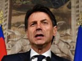 italian banking sector hit by sharp sell-off and its debt costs surge amid fears of row with eu