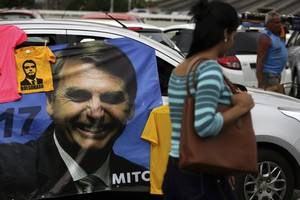 bolsonaro accused of breaking brazil's campaign finance law with whatsapp campaign