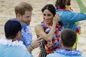 Meghan Markle displays tiny baby bump in action packed day with Prince Harry in Australia
