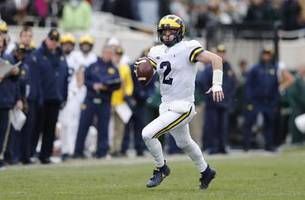 Patterson-led No. 6 Michigan tops No. 24 Michigan State 21-7