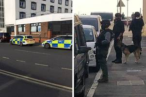 Pictures show armed police response in Folkestone after reports a man was seen with a weapon