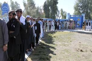 afghans go to polls amid violence and corruption claims