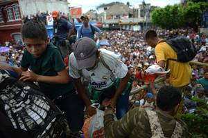 migrants camp on bridge between guatemala and mexico as u.s. pressure mounts