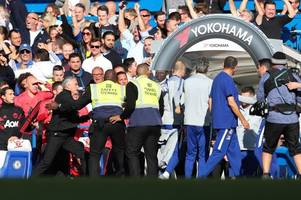 Manchester United boss Jose Mourinho held back by stewards after wild Chelsea celebrations
