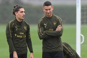 arsenal picture special: boost for unai emery as injured duo train ahead of leicester clash