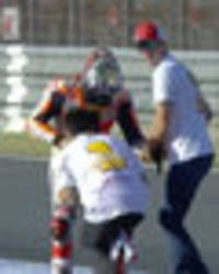 marc marquez: motogp star wins world title... but dislocates shoulder celebrating - pics