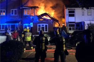 Woman dead after 'gas explosion' rips through flat and sets building on fire