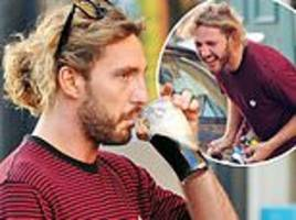 Strictly's Seann Walsh star chugs Guinness on the street despite 'show bosses banning boozing'
