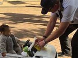Traffic warden gives bemused toddler a 'fine'
