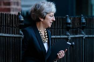Theresa May claims Brexit transition period will end 'well before' 2022