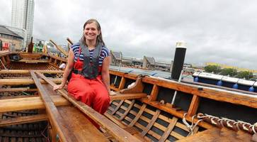 belfast boat builder behind inspirational 'community currach' honoured by theresa may