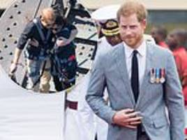 prince harry to palace aides: 'i'm in the middle of a conversation'