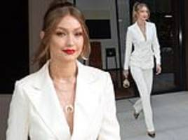 gigi hadid stuns in a stylish white suit and bold red lips