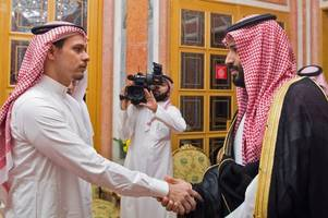Murdered journalist Jamal Khashoggi's son glares at Saudi Prince accused of his death in face-to-face meeting