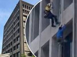 window washer is rescued after dangling from a skyscraper in california when cable failed