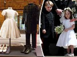prince george and princess charlotte's royal wedding outfits displayed at windsor castle