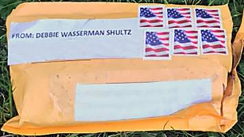 a man is in custody in connection to 12 suspicious packages