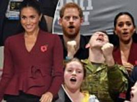 harry and pregnant meghan attend an invictus games basketball match