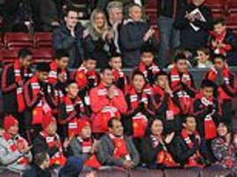 thai cave boys attend manchester united match as guests of honour at old trafford