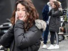 michelle keegan braves the cold to take a phone call on set of new comedy series brassic